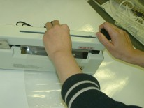 Allows users to trim off any unwanted part of the bag with the cutter at the handle.